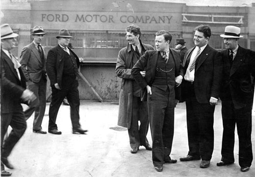 Three Ford men, left, approach union leaders Robert Kanter, Walter Reuther, Richard T. Frankensteen and J.J. Kennedy. (Scotty Kilpatrick / The Detroit News)