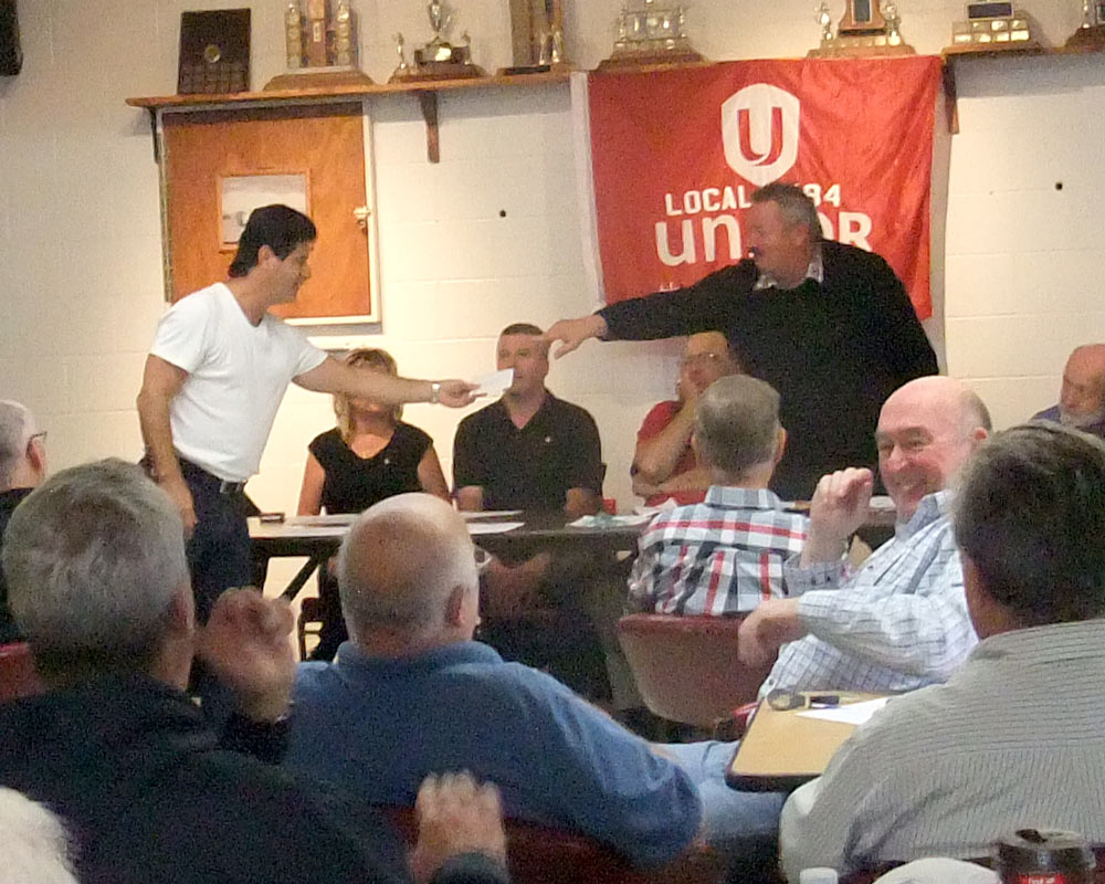 Dias receives gift from retirees local 584