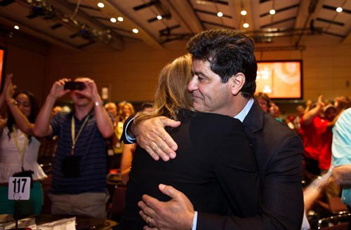 Jerry Dias hugs his wife Leslie after being declared the first president of Unifor at the Unifor founding convention in Toronto, Saturday, August 31, 2013. Dias, assistant to CAW national president Ken Lewenza, was chosen Saturday at the founding convention of Unifor, a merger of the CAW and the Communications, Energy and Paperworkers Union of Canada.