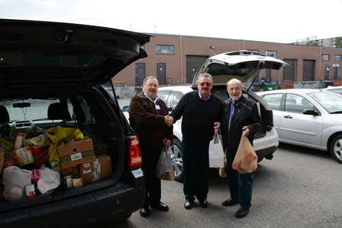 Doug Berry, Chris Wilski and Frank Marek unload food at the Knights Table