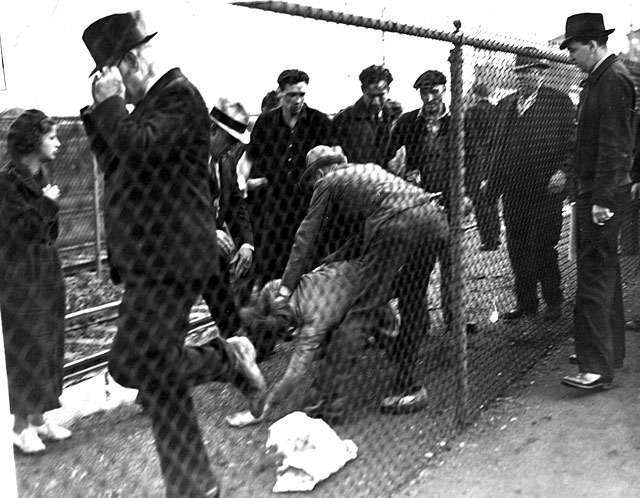 An unidentified UAW organizer is soundly beaten by a group of Ford Service Department employees during the Battle of the Overpass. Second from right is Sam Taylor.