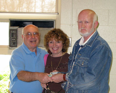 Norm Collins & Roz Monchamp with the 50/50 winner Ron Heffell