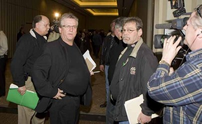 Top Canadian Auto Workers union officials, Bob Chernicki, left with green folder, Ken Lewenza and Rick Laporte, right, after yesterday's news conference.