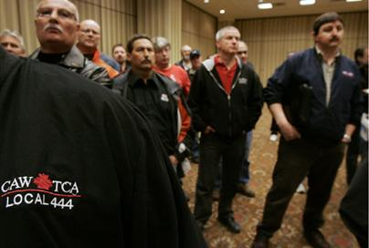 Members of the Canadian Auto Workers union listen at a news conference in Toronto, March 27, 2009. Union president Ken Lewenza said Chrysler and trhe CAW union are still far apart in negotiations to ...