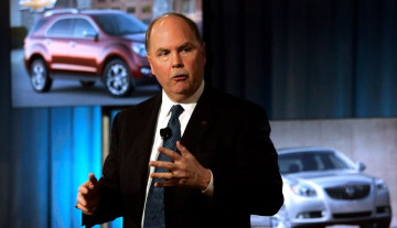 General Motors CEO Fritz Henderson speaks to the media in Detroit on Monday. Rebecca Cook/REUTERS