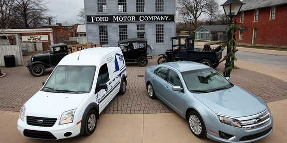 Detroit Free Press Car and Truck of the Year - 2010 Ford Fusion Hybrid (right) and 2010 Ford Transit Connect. The two vehicles were photographed at Greenfield Village in front of Model T trucks and the building that is modeled after Henry Ford's first factory in Detroit. (MARCIN SZCZEPANSKI/Detroit Free Press)
