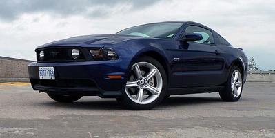 The 2010 Mustang gets an upgraded interior, tweaked styling, improved suspension and more power.