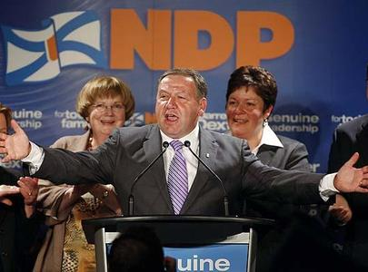 Nova Scotia NDP Leader Darrell Dexter celebrates with supporters in Dartmouth, N.S., after historic election win.