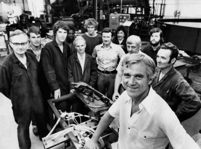 Frank Stronach, front, and employees, 1977.