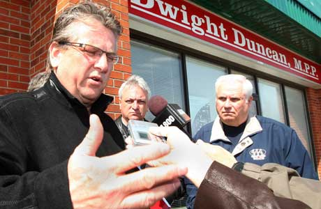Ken Lewenza, president of the Canadian Auto Workers (L) Mike Vince, CAW local 200 president and Gary Parent Windsor and District Labour Council president speak to the media outside of MPP Dwight Duncan's constituency office in Windsor, Friday, April 10, 2009.Photograph by: Dan Janisse, The Windsor Star
