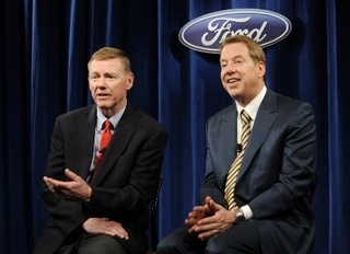 Alan Mulally, CEO of Ford, left, and Executive Chairman Bill Ford address the news media Thursday after Ford's annual shareholders meeting in Wilmington, Del. Mulally said that he expects the company's performance to improve through 2011 as the economy recovers. (BRADLEY C. BOWER/Bloomberg News)