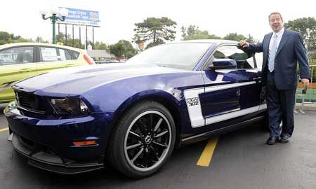 "Bill Ford Jr. shows off a new 2011 Boss 302 Mustang at the Woodward Dream Cruise. Despite the challenges, he says, ""I wouldn't change places with anybody in this industry today."" Hybrids and electric vehicles ""will become a core competency,"" he says. (Charles V. Tines / The Detroit News)"