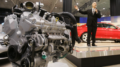 Ken Czubay, Ford vice-president of sales and marketing, discusses the automaker's new EcoBoost engine, left, during a preview at the Cleveland auto show Friday, Feb. 27, 2009, in Cleveland. (AP Photo/Mark Duncan)