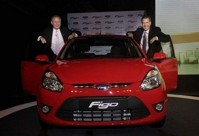 Ford executives Michael Boneham, left, and Joe Hinrichs introduce the new Figo in New Delhi, India, on Tuesday. (Manish Swarup / Associated Press)