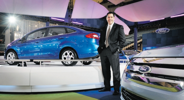 From the floor of the Vancouver International Auto Show on Tuesday, Ford Canada CEO David Mondragon says the Ford Fiesta (in background) gets 50 miles to the gallon or 100 km on five litres of gas. The show runs at BC Place Stadium until Sunday.Photograph by: Ian Lindsay, PNG, Vancouver Sun