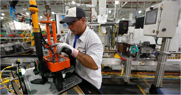 A worker assembles a transmission at a Ford plant in Sterling Heights, Mich.. Ford had its best third quarter in more than 20 years