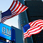 Flags fly outside the headquarters building of General Motors in Detroit, Michigan, on June 1, 2010. (Photo: Jeff Kowalsky / Bloomberg via Getty Images)