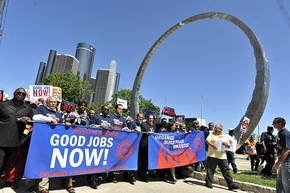 United Auto Workers members march in Detroit on Wednesday after Bob King's election as president. (David Coates / The Detroit News)