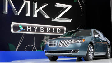 A Lincoln MKZ Hybrid is unveiled earlier this year at the New York International Auto Show in New York. Ford Motor Co. will soon have a first in the U.S. auto market: a hybrid sedan that costs the same as the gas-powered version. David Goldman/AP