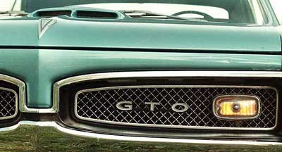 The hood ornament of a 1967 Pontiac GTO. Pontiac, whose GTO and Firebird muscle cars defined fast rides, drive-ins and cruising for a generation of teenage boys, is going out of business. (AP Photo/Journal Times, Mark Hertzberg, File)