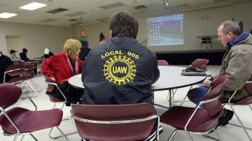 UAW members attend a meeting in December, 2008, in which they were given details about their imminent layoffs at a GM plant in Warren, Mich. 2008 Getty Images