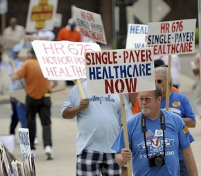 UAW members supporting a single-payer health system protest outside of Cobo Hall, Sunday. (David Guralnick / The Detroit News)