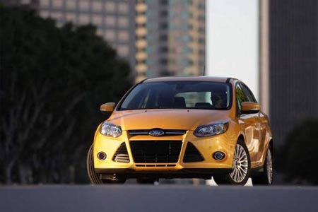 The all-new 2012 Ford Focus. A version gets 40 m.p.g. on the highway, and the announcement comes as gas prices have surged across the country. / Ford