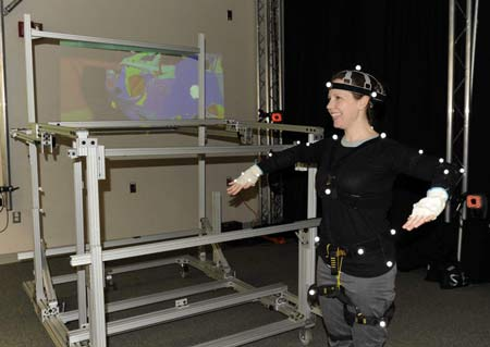 Patty Racco, a Ford manufacturing ergonomic engineer, demonstrates how her movements help digital models become more realistic. (Charles V. Tines / The Detroit News)