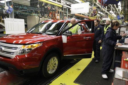 Plant employees assemble a 2011 Ford Explorer in December at Ford's Chicago Assembly Plant. Sales for the new model have surpassed expectations, and some dealers report selling vehicles right off the truck. (M. Spencer Green / Associated Press)