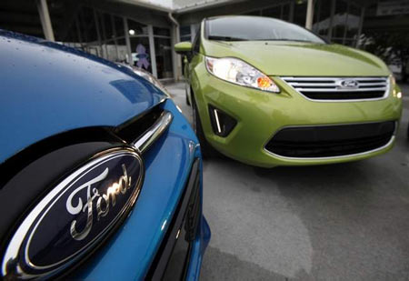 A 2012 Ford Focus and a 2012 Ford Fiesta at the Maroone Ford of Miami dealership in Miami. Smaller cars are on pace for a sales increase of more than 20 percent this year, Ford said today. (Wilfredo Lee / Associated Press)