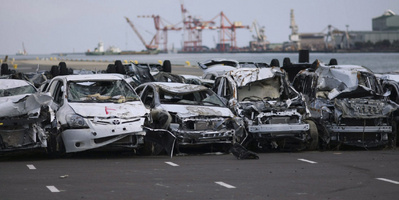 New vehicles damaged by the March 11 tsunami sit lined in a Toyota parking lot at Sendai port, Miyagi Prefecture, northeastern Japan, Monday, March 28, 2011.