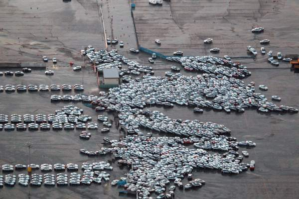 Vehicles ready for shipping were carried off by Friday's tsunami in Hitachinaka. U.S. carmakers, with only small Japan offices, reported no impact . (Getty Images)