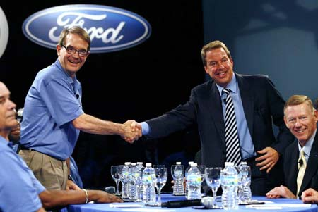 UAW president Bob King, left, shakes hands Friday with Bill Ford Jr., executive chairman of Ford Motor Co., during the traditional handshake to launch the start of contract negotiations at the River Rouge Plant in Dearborn. CEO Alan Mulally, right, looks on. (Gary Malerba / Special to The Detroit News)