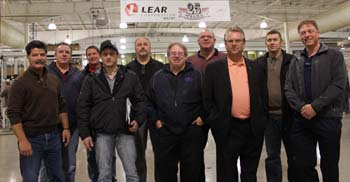 CAW President Ken Lewenza joins with Lear Corporation Unit Chairperson Scott Bateman (fourth from right) at 25th anniversary celebrations at the Local 222 plant in Whitby, Ontario recently.