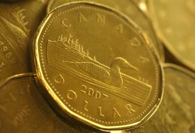 The high Canadian dollar and a potential free-trade agreement with Korea pose a threat to the domestic automakers, the federal government was told Friday, Feb. 18, 2011, in Toronto.