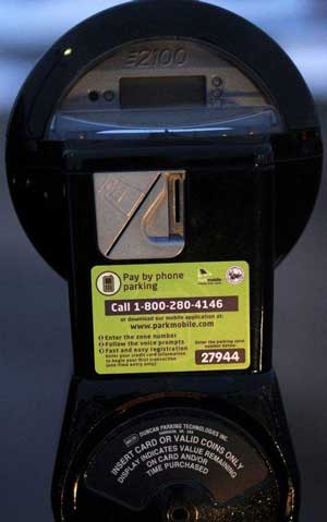 Motorists can pay for parking with smartphones in meters off West Village Drive in Dearborn. (Elizabeth Conley / The Detroit News)