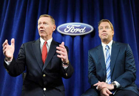 Ford President and CEO Alan Mulally, left, and Executive Chairman Bill Ford address the media during a news conference after Ford's meeting of shareholders Thursday in Wilmington, Del. Mulally said Ford expects global sales of 8 million vehicles by 2015 from 5.3 million in 2010. / William Thomas Cain/Getty Images