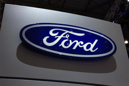 A Ford logo is seen on the car maker's booth during the first media day of the Geneva Auto Show at the Palexpo in Geneva, March 6, 2012