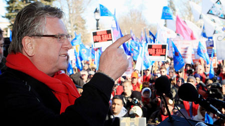 Ken Lewenza, CAW National President, speaks at a rally dubbed a 'London Day of Action Against Corportate Greed,' in London, Ont., on January 21, 2012. (Dave Chidley / THE CANADIAN PRESS)