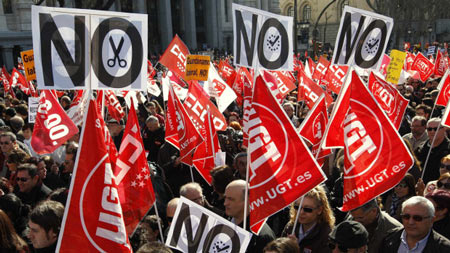 People protest against the labour reform of the Spanish government in central Madrid February 19, 2012.