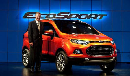President and CEO, Ford Motor Company Alan Mullaly previews the new Ford EcoSport car in New Delhi on January 4. (MANAN VATSYAYANA/AFP/Getty Images)