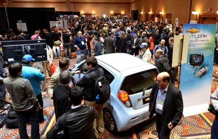 Visitors flood the 2013 International CES electronics show, where automakers stressed efforts to ramp up more advanced Internet-based radio and other music streaming. (Joe Klamar / Getty Images)