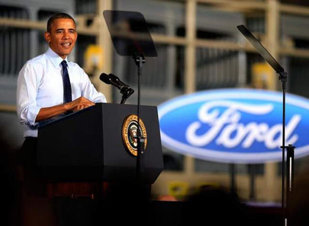 President Barack Obama speaks to workers as he visits the Ford Kansas City Stamping Plant in Liberty, Missouri. Obama toured the facility and spoke to employees. (Jamie Squire / Getty Images)