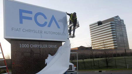A new Fiat Chrysler Automobiles sign is unveiled at Chrysler Group World Headquarters in Auburn Hills, Mich., May 6, 2014.