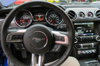 The interior of the 2015 Mustang is a mixture of signature design elements like the twin-brow instrument panel to the latest Ford connectivity.
