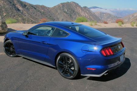 The 2015 Mustang is the most aerodynamic ever. Note the signature rear three-element taillights now with full LCDs.