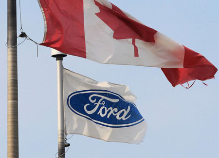 The Ford corporation flag and the Canada flag fly, at the Ford Essex Engine Plant in Windsor, Ont. (Dan Janisse/The Windsor Star)