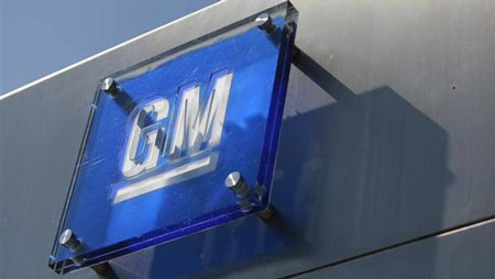 The General Motors logo is seen outside its headquarters at the Renaissance Center in Detroit in this file photo.