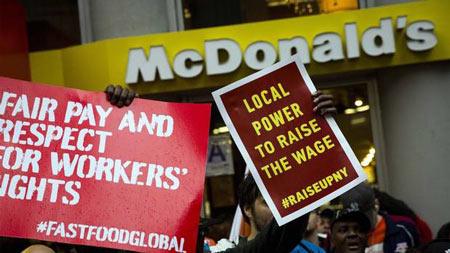 Demonstrators gather outside a McDonald's restaurant in New York, May 15, 2014.