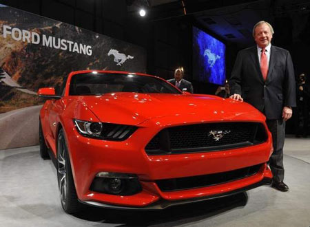 Edsel Ford II, the great-grandson of Henry Ford and a member of the board of directors of Ford Motor Co., poses with the all new 2015 Ford Mustang. (Charles V. Tines / The Detroit News)
